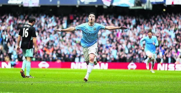 Samir Nasri celebrates opening the scoring on Sunday as Manchester City beat West Ham 2-0 to lift the ti